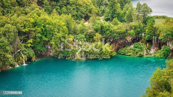 Waterfalls in Croatia Plitvice Lakes National Park. Scenic view from above towards several beautiful small waterfalls falling into the lake basin at the Plitvice Lakes National Park, Croatia, Europe