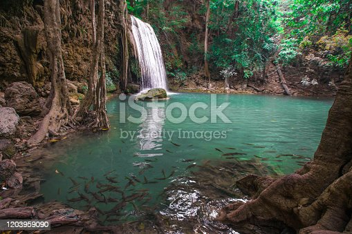 Waterfalls in the emerald blue water in Erawan National Park.beautiful natural rock waterfall in Kanchanaburi, Thailand.Onsen atmosphere.