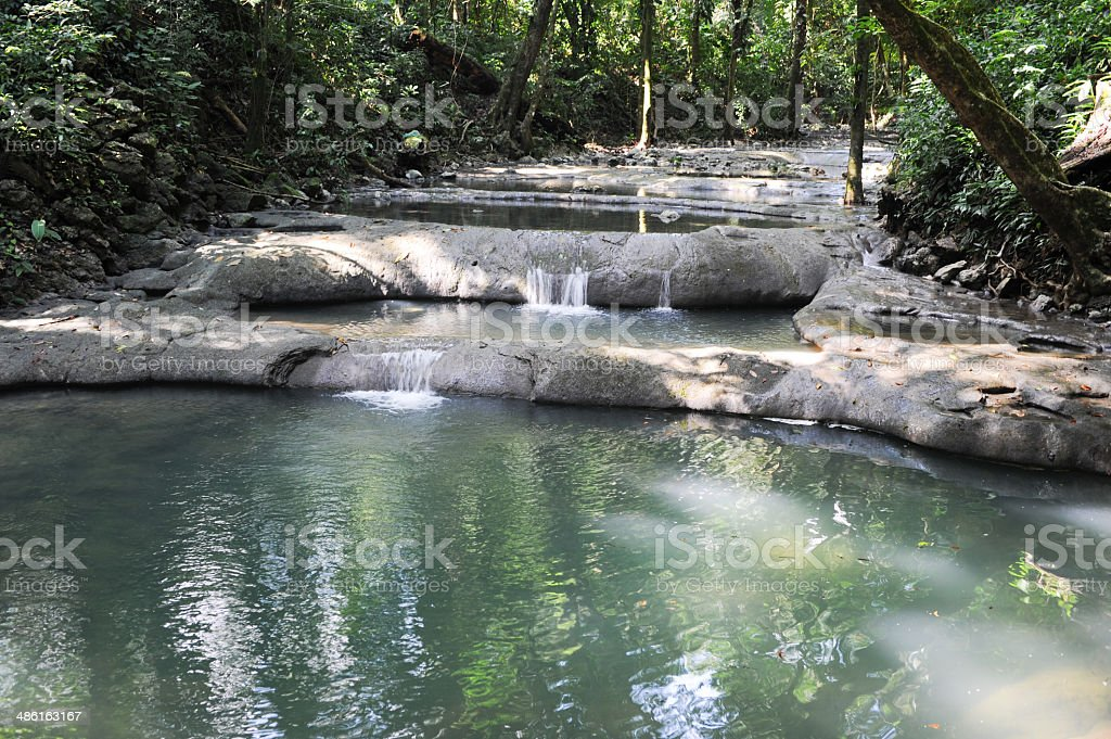 Waterfalls of siete altares on the forest at Livingston stock photo
