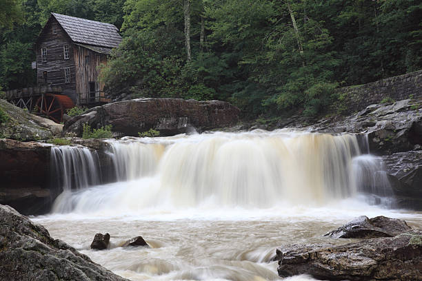 Waterfalls Waterfalls with gristmill in the background. babcock state park stock pictures, royalty-free photos & images