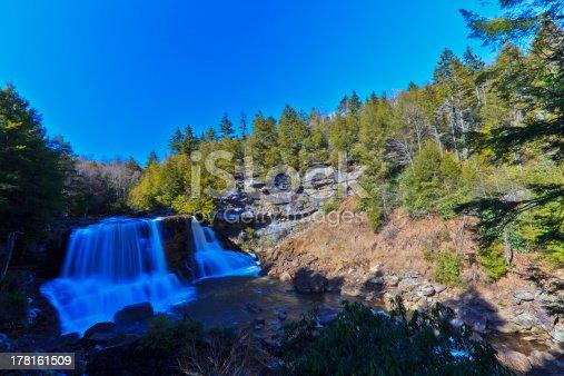 istock Waterfalls, tannin colored stream and rocks 178161509