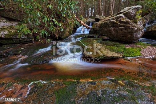 istock Waterfalls, tannin colored stream and rocks 178580417