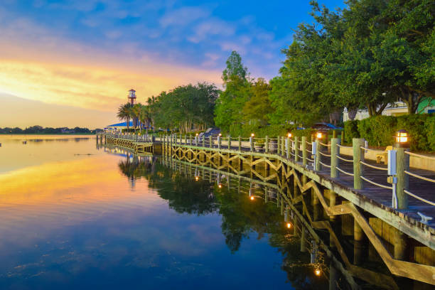 waterfront boardwalk at sunset in the villages, florida - orlando florida photos stock photos and pictures