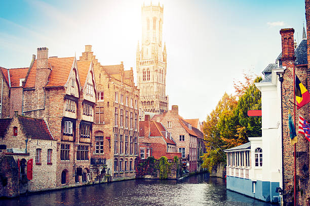 Waterfront Buildings in Bruges, Belgium View to the canals and Bell Tower of Bruges belgium stock pictures, royalty-free photos & images