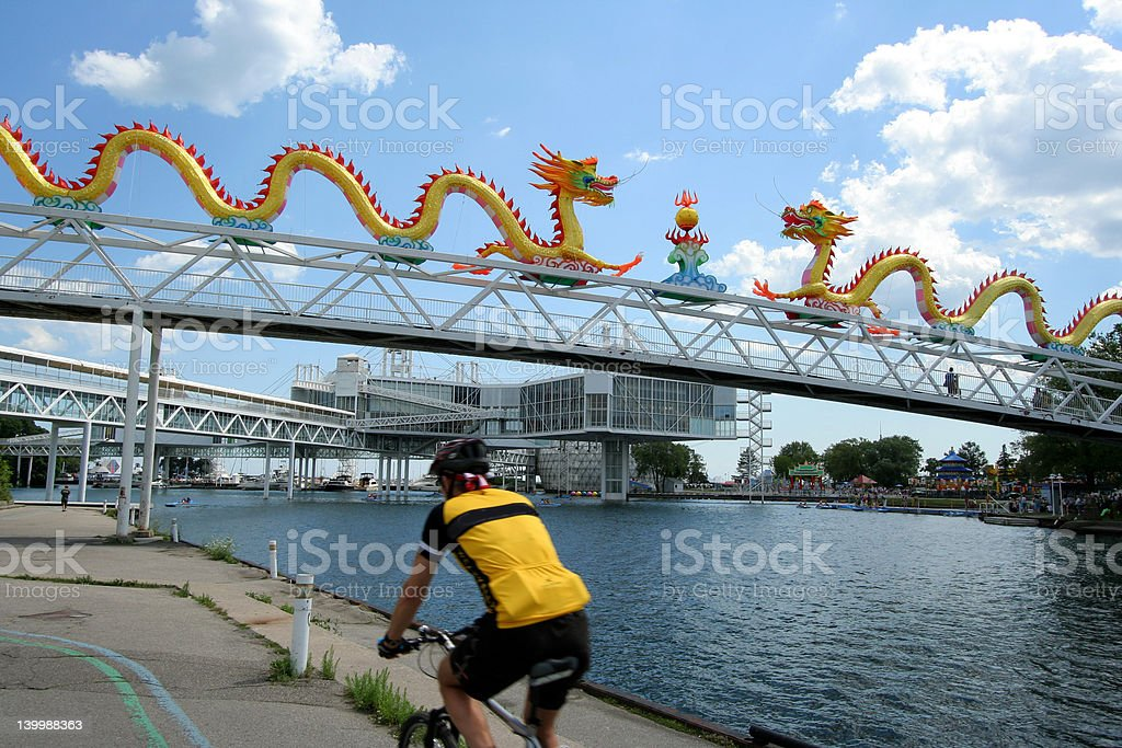 waterfront cyclist and chinese dragon royalty-free stock photo