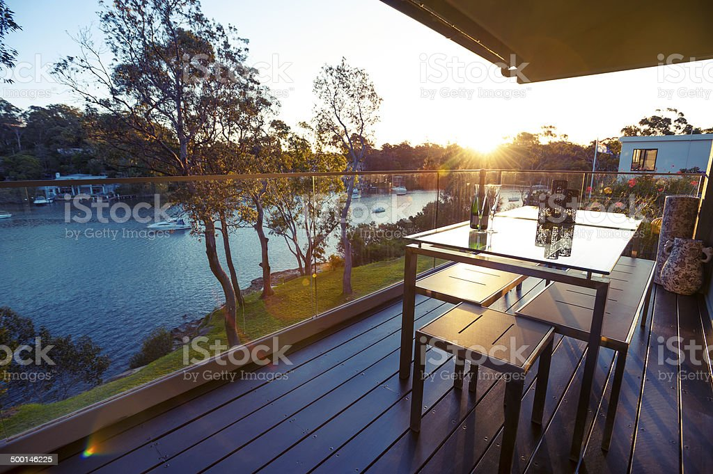 Waterfront house balcony stock photo