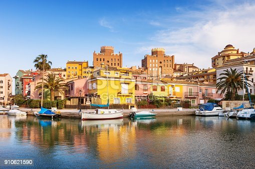 Stock photograph of the colorful waterfront in Port Saplaya, Valencia, Spain on a sunny day.
