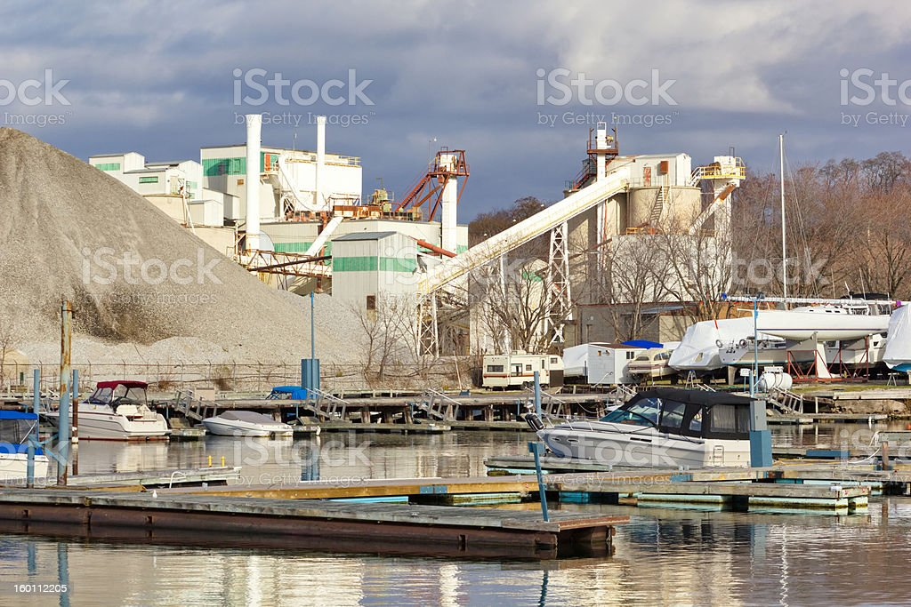 Waterfront Industry Factory and Pleasure Craft Marina Together stock photo