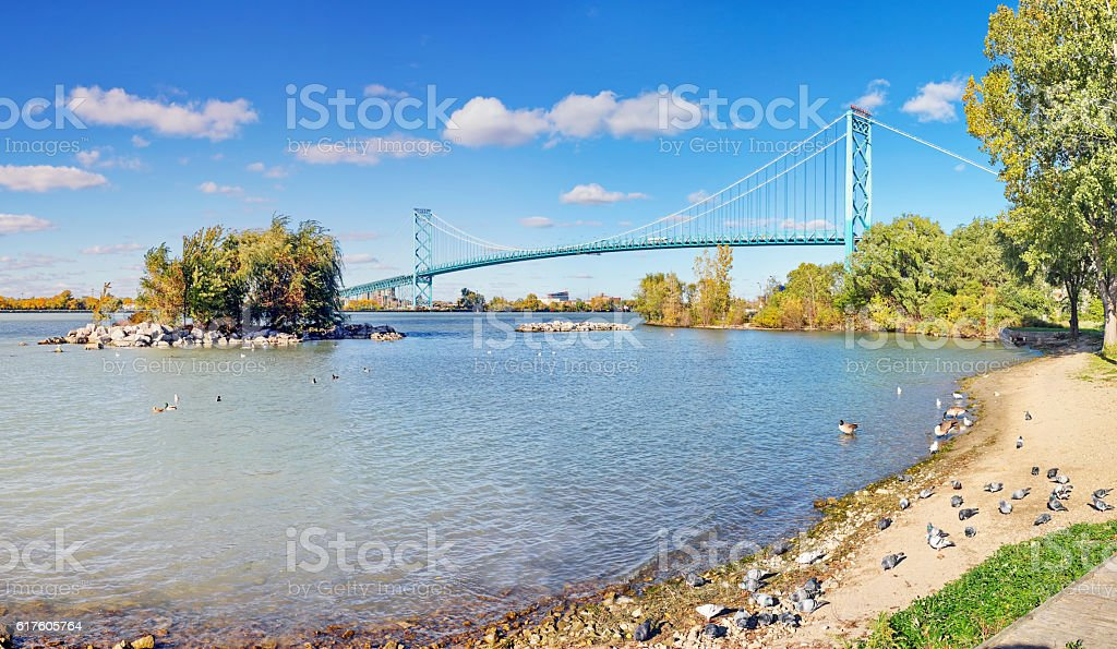 Waterfront Park Views of Ambassador Bridge on the Detroit River stock photo