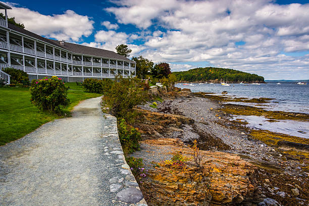 Waterfront path and hotel in Bar Harbor, Maine. stock photo