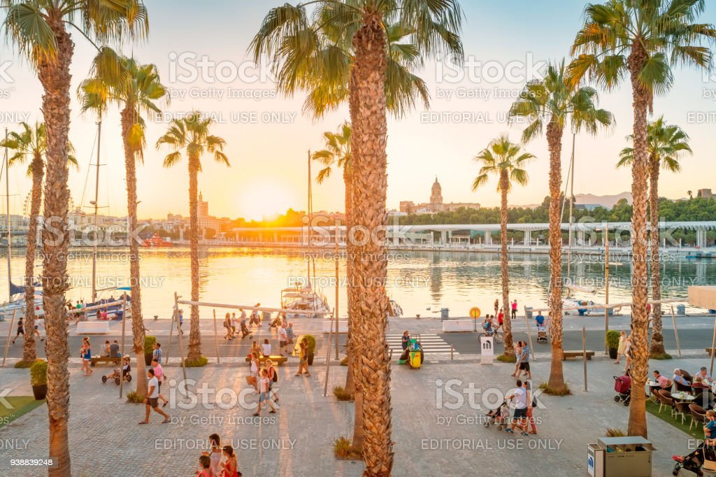 Waterfront promenade in downtown Malaga Spain at sunset stock photo