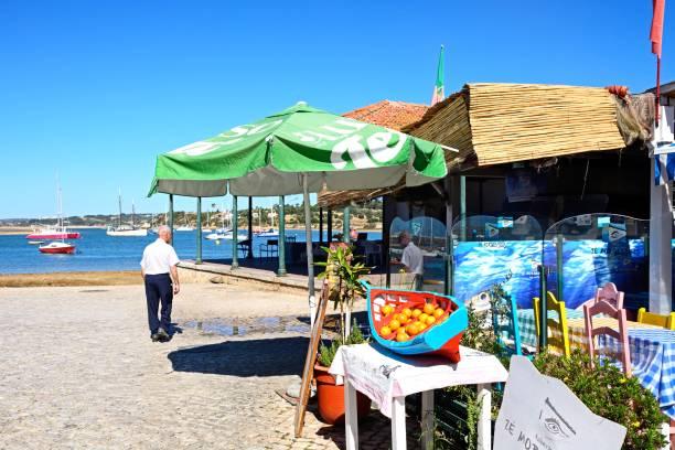 waterfront restaurants, alvor. - esplanada portugal imagens e fotografias de stock