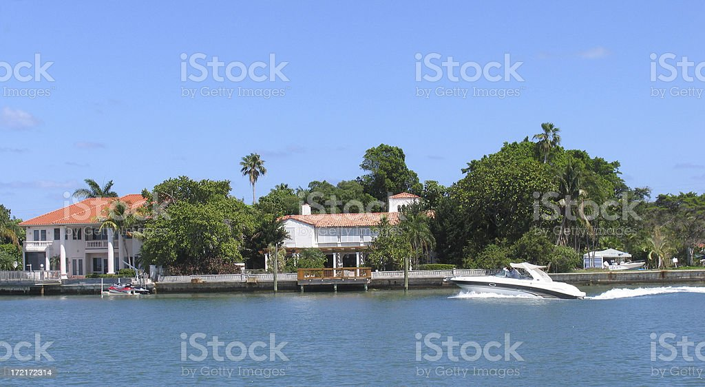 Waterfront scene with boat speeding by royalty-free stock photo