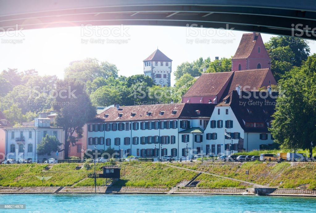 Waterfront view of Basel under bridge across Rhine stock photo