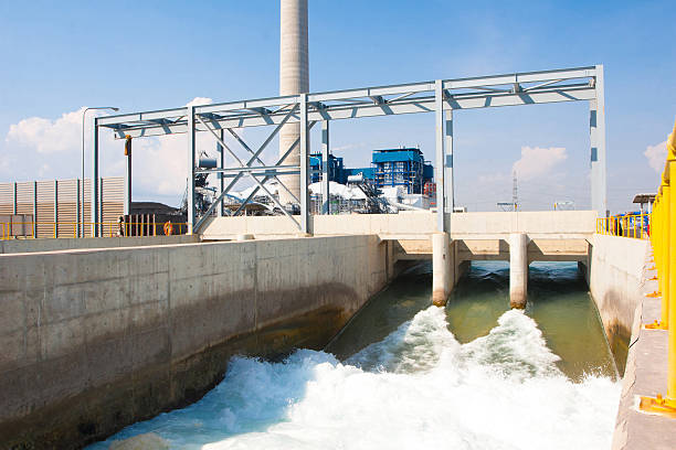 Watergate draining clean water to river after wastewater treatment stock photo