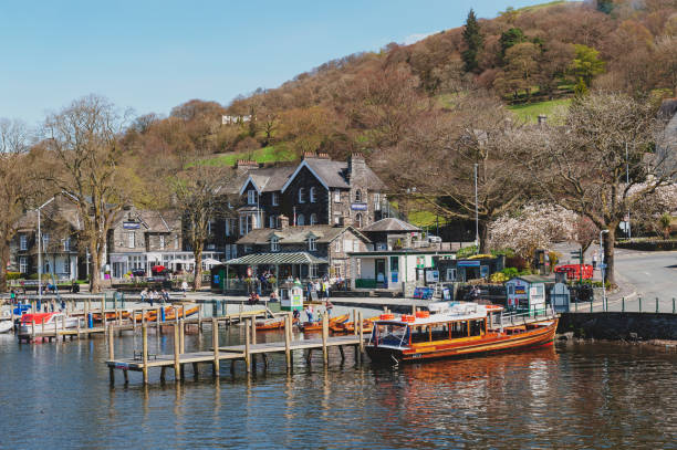 Waterhead Pier at Ambleside, a lakeside town situated at the head of Windermere Lake within the Lake District National Park in England stock photo