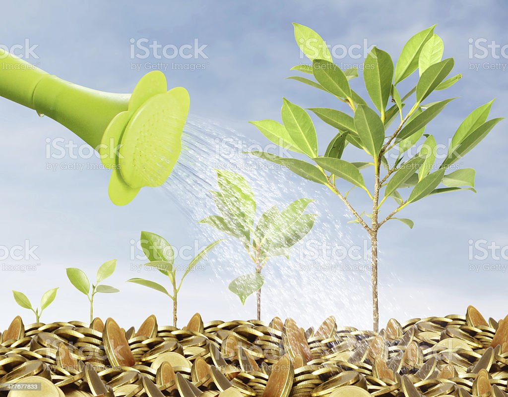 watering can pouring molten gold coins royalty-free stock photo