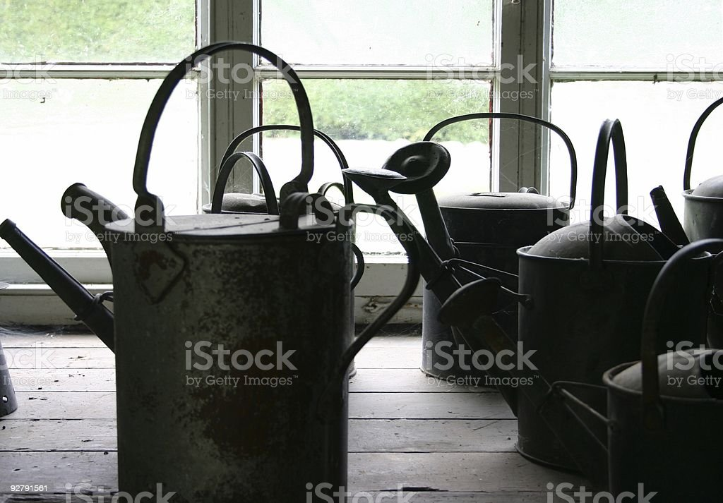 watering cans at an English gardens royalty-free stock photo