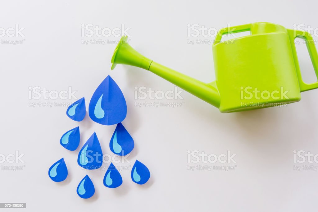 watering pot and and water droplets photo libre de droits