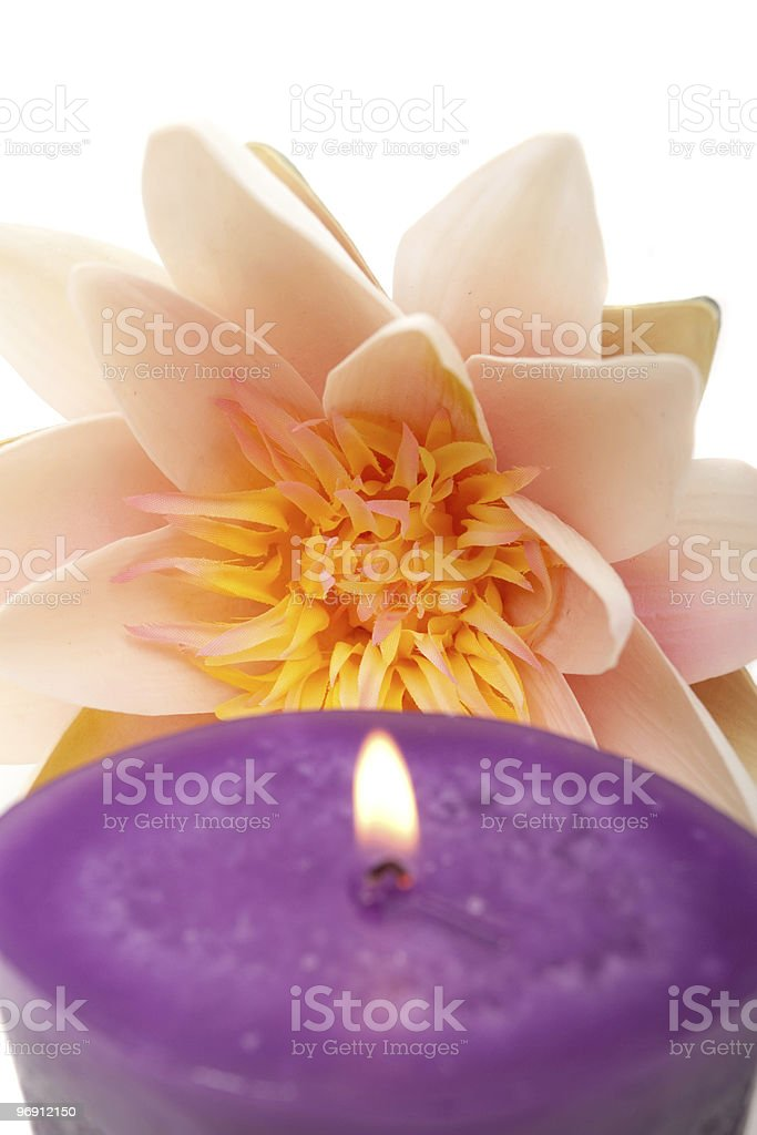 Waterlily and candle spa decor royalty-free stock photo