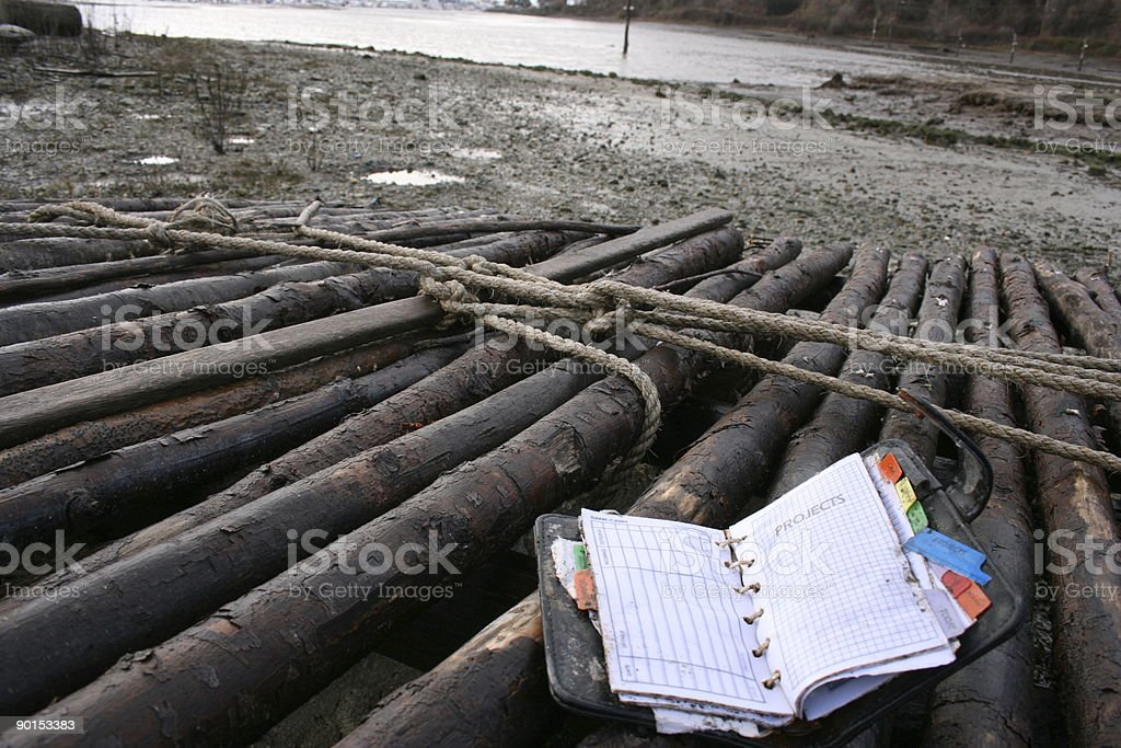 Waterlogged Day planner on river raft royalty-free stock photo