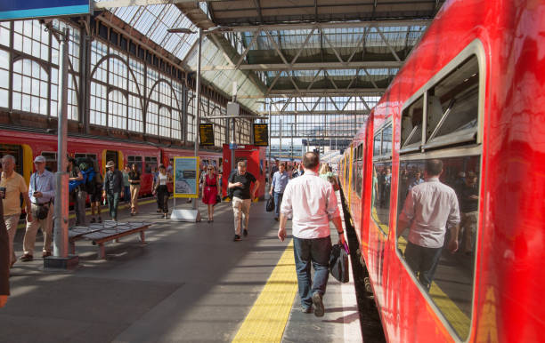 Waterloo train station. Train ready to depart. View on the platform and walking people. London, UK London, UK - July 29, 2019: Waterloo train station. Train ready to depart. View on the platform and walking people depart stock pictures, royalty-free photos & images