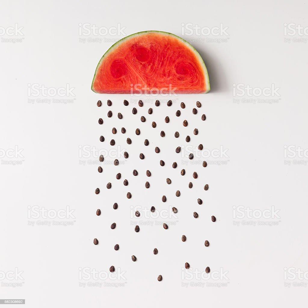 Watermellon slice with seeds raining stock photo
