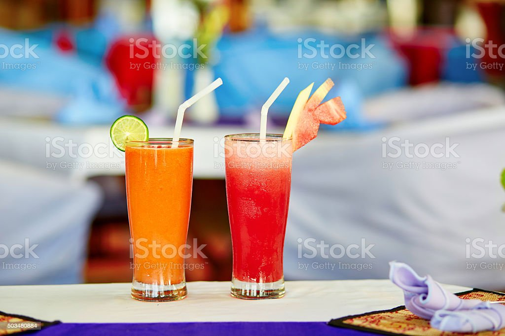 Watermelon and papaya juices stock photo