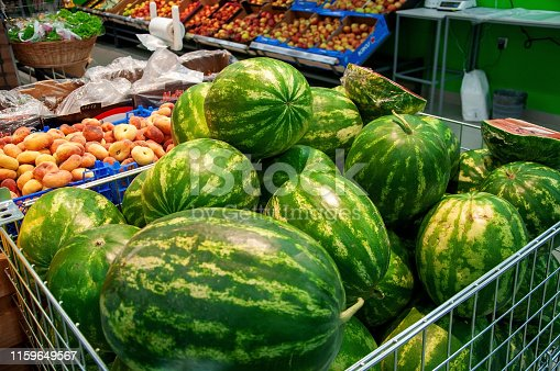 Watermelon and peaches for sale in a supermarket in Russia. Vegetables and fruits on the counter