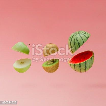 istock Watermelon, apple and kiwi sliced on pastel pink background. Minimal fruit concept. 860594222