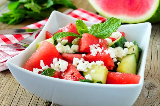 watermelon, cucumber and feta cheese salad, close up - karpuz stok fotoğraflar ve resimler