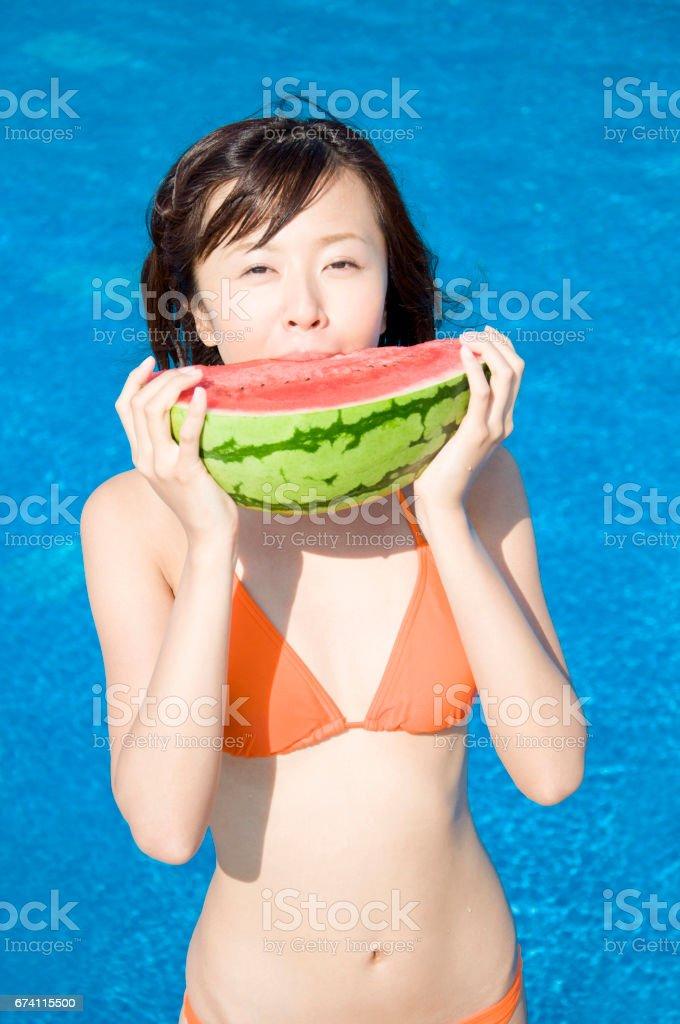 Watermelon eating swimsuit women royalty-free stock photo
