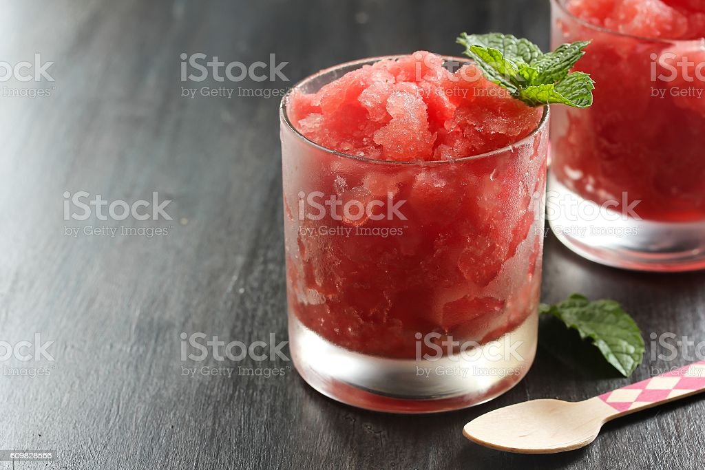Watermelon Granita on dark moody background stock photo