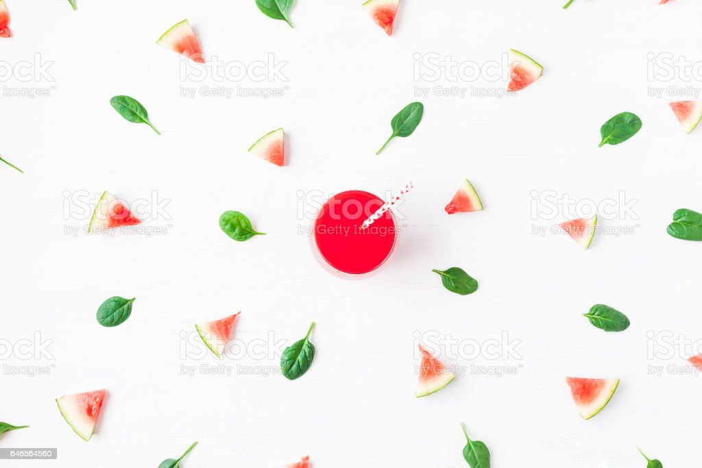 Watermelon juice, watermelon slices and spinach leaves stock photo
