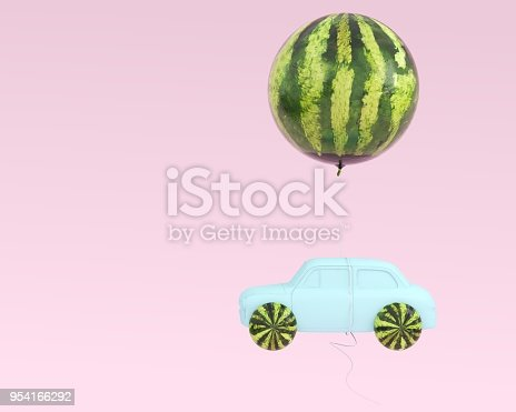 945748362istockphoto Watermelon layout wheel and car blue with watermelon balloon floating on pastel pink background. minimal idea food and fruit summer concept. 954166292