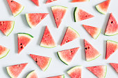 Watermelon pattern. Red watermelon on blue background. Summer concept. Flat lay, top view, copy space, square