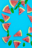 istock Watermelon pattern. Red watermelon on blue background. Summer concept. Flat lay, top view, copy space 1253894150