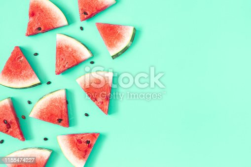 Watermelon pattern. Red watermelon on mint background. Summer concept. Flat lay, top view, copy space