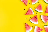 Watermelon pattern. Red watermelon on yellow background. Summer concept. Flat lay, top view