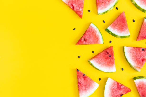 Watermelon pattern. Red watermelon on yellow background. Summer concept. Flat lay, top view stock photo