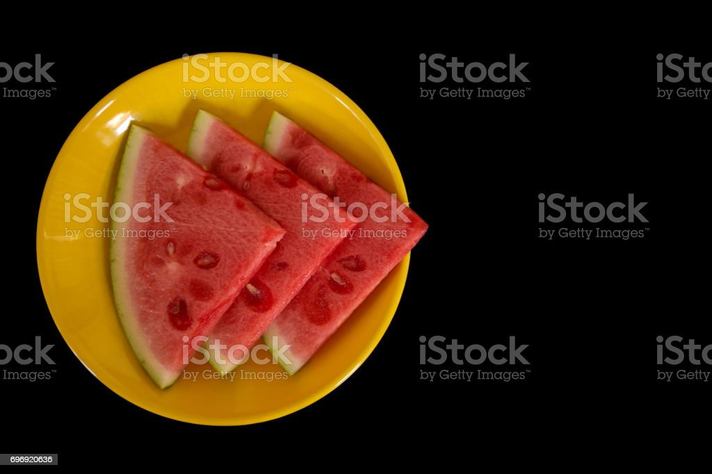 Watermelon pieces looking like fast forward sign stock photo