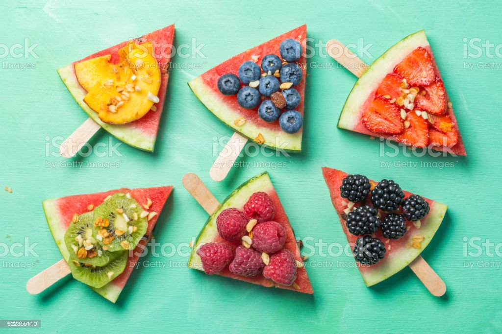 Watermelon pizza - slices with berries and fruits, granola. Fresh low carb diet stock photo