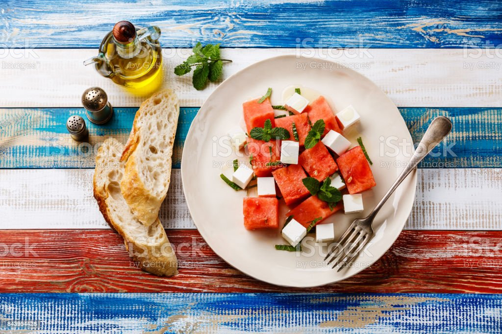 Watermelon salad with feta cheese stock photo