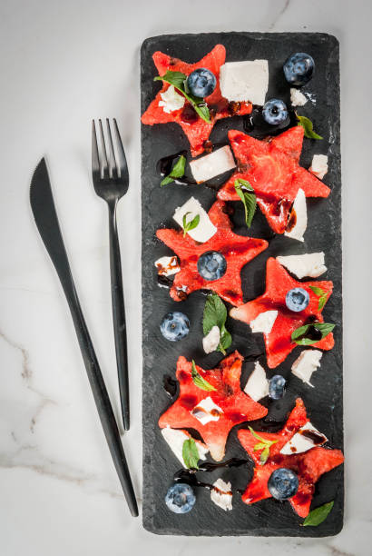 Watermelon salad with feta, mint, blueberry stock photo