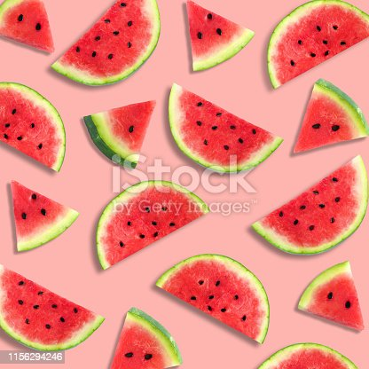 Colorful summer fruit pattern of watermelon slices on a pastel pink background