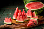 Watermelon sliced on wood background