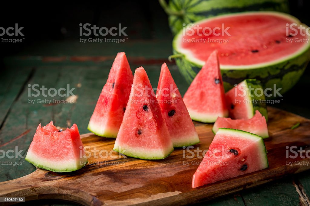 Watermelon sliced on wood background stock photo