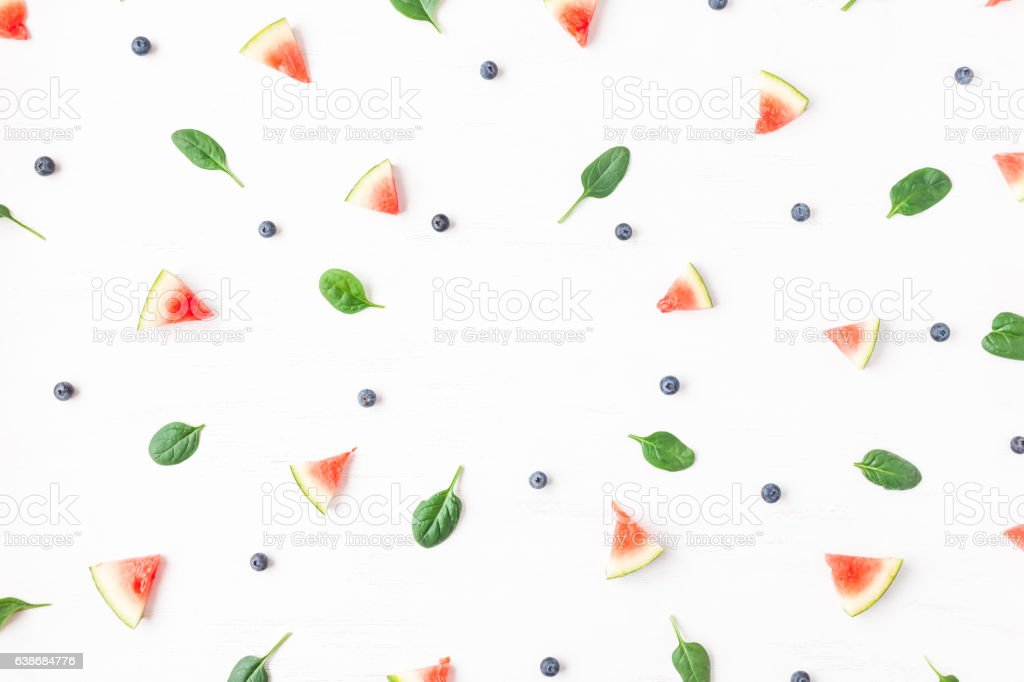 Watermelon slices, blueberry and spinach leaves. Summer concept. Flat lay