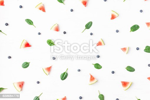 801463056istockphoto Watermelon slices, blueberry and spinach leaves. Summer concept. Flat lay 638684776
