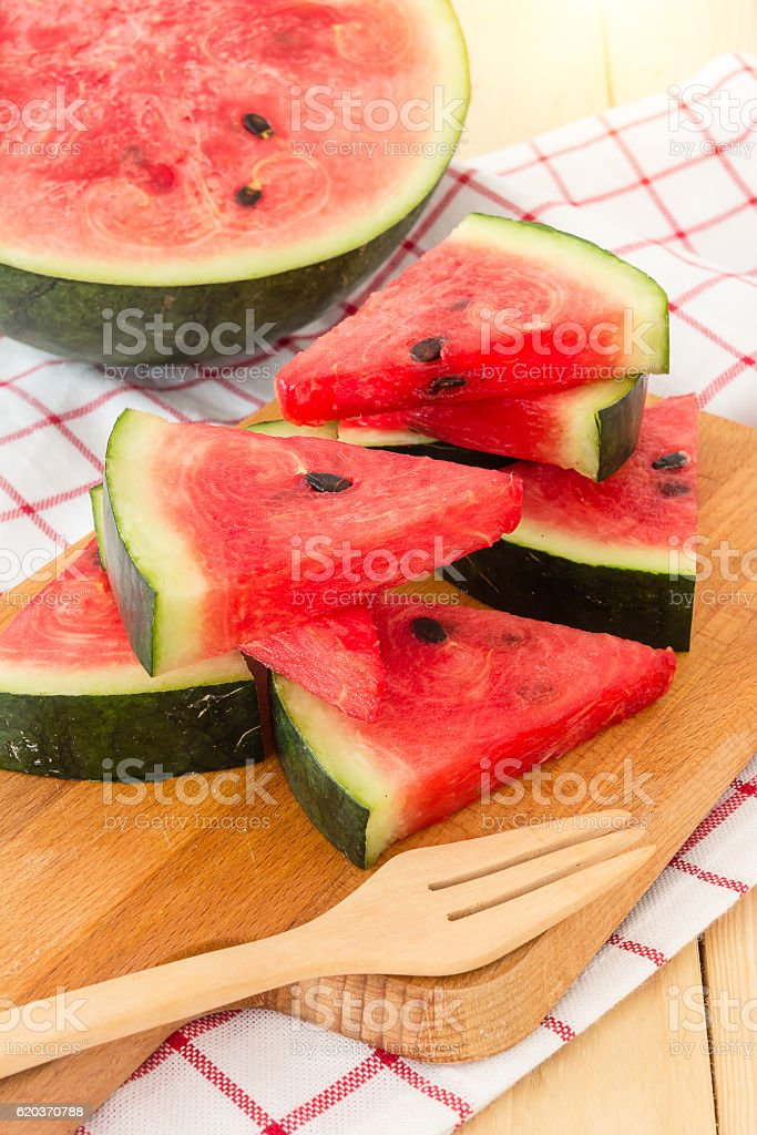 Watermelon slices on wooden board, served with napkin on a wooden Table foto de stock royalty-free
